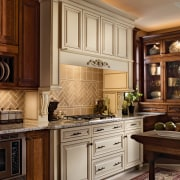 View of a kitchen which features cabinetry available cabinetry, countertop, cuisine classique, furniture, interior design, kitchen, room, under cabinet lighting, brown, orange