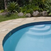 View of a pool with paving that features backyard, leisure, swimming pool, water, yard, teal