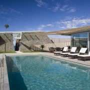 Exterior view of the outdoor area with pool, estate, home, house, leisure, property, real estate, reflection, resort, sky, swimming pool, villa, water, blue
