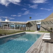 Exterior view of the outdoor area with pool, condominium, estate, home, house, leisure, property, real estate, resort, resort town, sky, swimming pool, villa, water, blue, gray