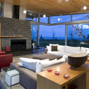 View of lounge, red couches, fireplace, schist wall, architecture, home, house, interior design, living room, real estate