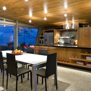 View of the open-plan kitchen and dining area architecture, interior design, real estate, table, brown