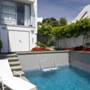 Image of the pool which has been designed apartment, backyard, condominium, estate, home, house, leisure, outdoor furniture, property, real estate, residential area, resort, sunlounger, swimming pool, vacation, villa