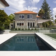Image of the pool which has been designed architecture, estate, home, house, mansion, property, real estate, residential area, swimming pool, villa, white