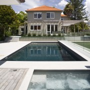 Image of the pool which has been designed architecture, backyard, estate, home, house, property, real estate, reflection, residential area, swimming pool, villa, water, white