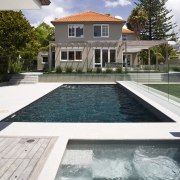 Image of the pool which has been designed architecture, backyard, condominium, estate, home, house, leisure, property, real estate, residential area, swimming pool, villa, water, white, gray