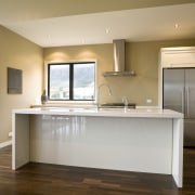 view of a show home kitchen where the cabinetry, countertop, floor, flooring, hardwood, home, interior design, kitchen, real estate, room, window, wood flooring, gray, brown