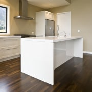 view of a show home kitchen where the cabinetry, countertop, floor, flooring, hardwood, home, interior design, kitchen, laminate flooring, property, real estate, room, wood, wood flooring, brown, gray