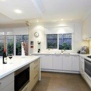 View of the kitchen area of a home countertop, cuisine classique, estate, interior design, kitchen, property, real estate, room, window, white, gray