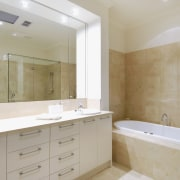 View of the bathroom of a home which bathroom, bathroom accessory, bathroom cabinet, floor, home, interior design, property, real estate, room, sink, tile, gray