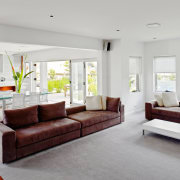 View of the lounge which runs into the ceiling, couch, floor, furniture, home, interior design, living room, property, real estate, room, gray