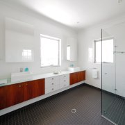 View of the bathroom of a family home bathroom, floor, home, property, real estate, room, sink, gray, white