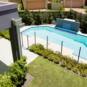 View of the swimming pool and outdoor area backyard, garden, grass, house, leisure, plant, property, real estate, residential area, roof, swimming pool, yard, brown