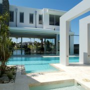 Exterior view of tropical resort-style house which was apartment, condominium, estate, home, hotel, house, property, real estate, resort, swimming pool, villa, white, teal