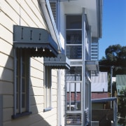 Exterior view of this renovated Brisbane home which house, siding, structure, black