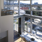 View of the main dining area featuring bamboo daylighting, glass, interior design, window, gray