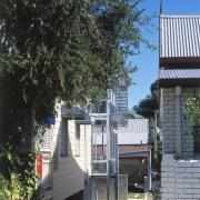 Exterior view of this renovated Brisbane home which architecture, cottage, home, house, neighbourhood, outdoor structure, plant, real estate, residential area, tree, black
