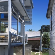 Exterior view of this renovated Brisbane home which architecture, building, daylighting, facade, house, real estate, residential area, window, black, gray