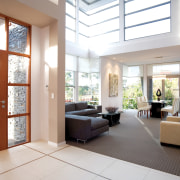 View of the living area of a high-end ceiling, daylighting, interior design, living room, lobby, real estate, window, white