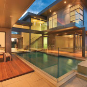 Exterior view of the outdoor area of this apartment, architecture, estate, home, house, interior design, property, real estate, swimming pool, window, brown, orange