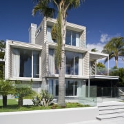 Exterior view of the rear of the renovated apartment, architecture, arecales, building, condominium, cottage, elevation, estate, facade, home, house, mansion, palm tree, property, real estate, residential area, resort, swimming pool, villa, window, white