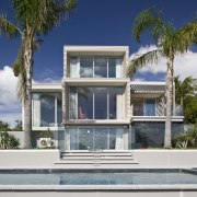 Exterior view of the rear of the renovated architecture, arecales, building, cottage, elevation, estate, facade, home, house, official residence, palm tree, property, real estate, residential area, villa, window, gray