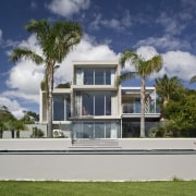 Exterior view of the rear of the renovated architecture, arecales, building, cottage, elevation, estate, facade, home, house, mansion, official residence, palm tree, property, real estate, residential area, sky, villa, gray, blue