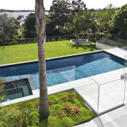 Exterior view of the rear of the renovated backyard, estate, grass, house, leisure, property, real estate, swimming pool, yard, white
