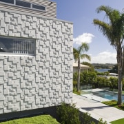 Exterior view of the rear of the renovated architecture, estate, facade, home, house, property, real estate, residential area, villa, wall, gray, white