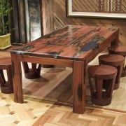 View of a table created by Ironwood Antique coffee table, end table, floor, flooring, furniture, hardwood, table, wood, wood stain, brown, orange