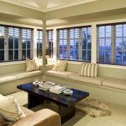 View of a living area, couches, coffee table, estate, home, interior design, living room, real estate, room, window, window blind, window covering, window treatment, orange, brown