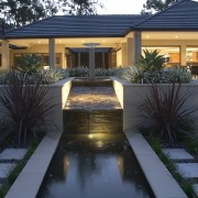 Exterior view of a home which was designed architecture, backyard, courtyard, estate, facade, home, house, landscape lighting, landscaping, lighting, property, real estate, residential area, siding, window, yard, black