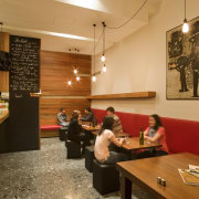 View of the cafe area which features terrazzo café, coffeehouse, furniture, interior design, restaurant, room, table, brown, orange