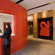 View of the reception area with an oval interior design, lobby, orange, red