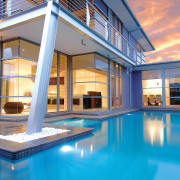Exterior view of a high-end custom designed home apartment, estate, home, house, leisure, property, real estate, reflection, swimming pool, villa, window, teal
