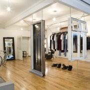 Interior view of the clothing displays at the boutique, floor, flooring, interior design, room, white