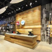 Interior view of the Quicksilver store in New interior design, retail, shoe store, wood, orange, black