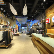 Interior view of the Quicksilver store in New retail, black, orange