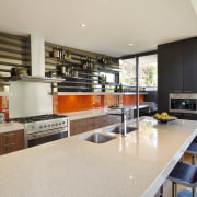 View of a cafe-styled kitchen which features an countertop, interior design, kitchen, real estate, gray
