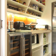 View of the scullery which features shelving, refrigeration, cabinetry, closet, furniture, kitchen, room, shelf, shelving, orange