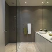 View of bathroom featuring vanity with CaesarStone tops, bathroom, floor, glass, interior design, plumbing fixture, room, sink, tile, gray, brown