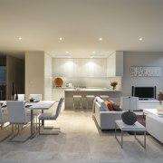 View of open-plan living and dining area with apartment, ceiling, floor, interior design, living room, real estate, table, gray, orange
