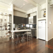 View of kitchen area with dark-stained timber flooring, floor, flooring, interior design, kitchen, loft, wood flooring, white, brown