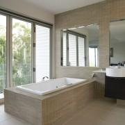 View of a bathroom which features Scyon Secura bathroom, bathtub, floor, flooring, home, interior design, room, tile, wall, window, gray