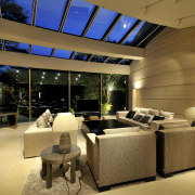 View of the living area with sofas, TV, architecture, ceiling, interior design, living room, lobby, real estate, brown