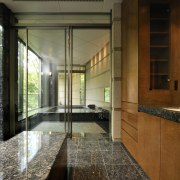 View of the bathroom which features extensive granite architecture, countertop, estate, home, house, interior design, real estate, window, brown
