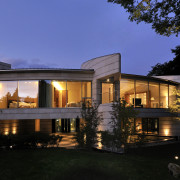 Exterior view of home with stainless steel roof, architecture, cottage, estate, evening, facade, home, house, landscape lighting, lighting, mansion, property, real estate, residential area, roof, villa, window, black, blue