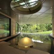 View of a giant water feature with a architecture, daylighting, estate, home, house, interior design, lighting, lobby, real estate, sunlight, brown