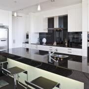 View of the kitchen white lacquered cabinets, black countertop, cuisine classique, interior design, kitchen, white, black