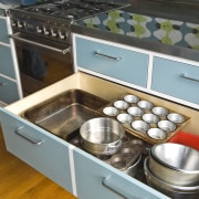 View of blue-painted kitchen cabinetry. - View of countertop, drawer, furniture, kitchen, gray